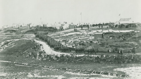 A black-and-white photo shows Union troops conducting drills in snow-blanketed hills near Washington, D.C., circa 1861–65. | Episode 2 | A Very Bloody Affair (1862)
