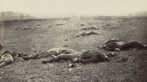 A sepia-toned photo of dead Union soldiers laying on the ground at Gettysburg, Pennsylvania, circa 1863. | Episode 5 | The Universe of Battle (1863)